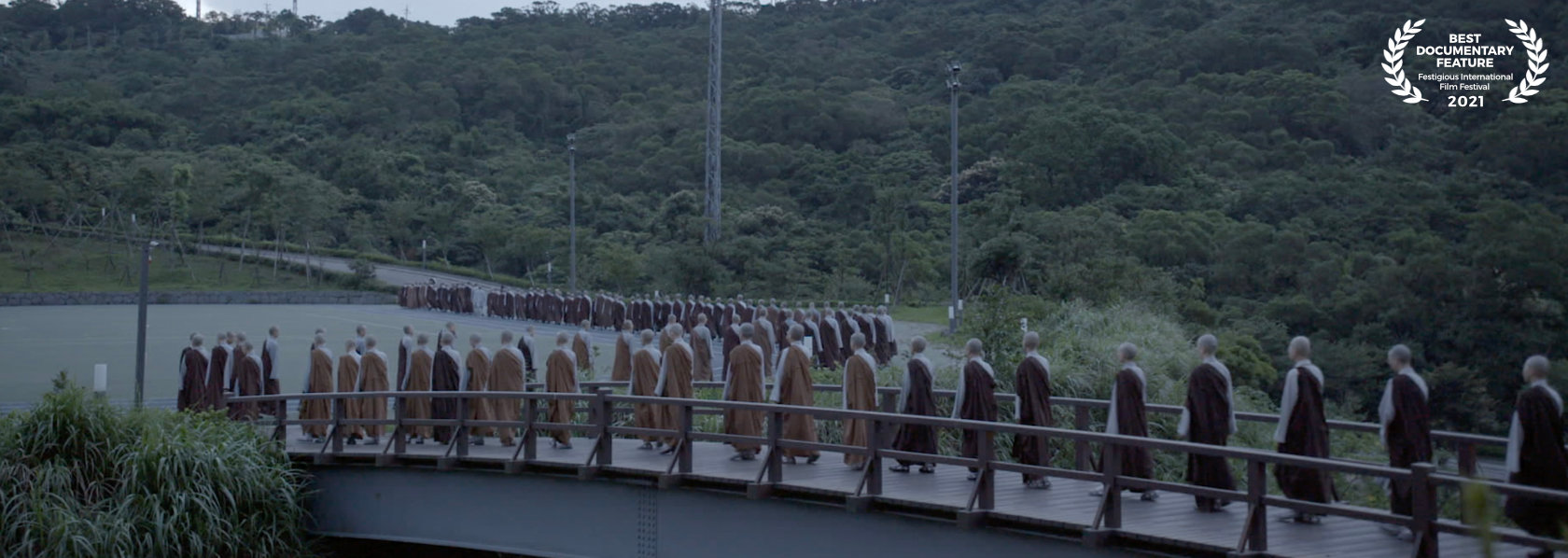 A group of monks and nuns walking on a bridge - Master Sheng Yen - THIS Buddhist Film Festival
