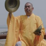 Elderly monk playing cymbals - Music Monks - THIS Buddhist Film Festival