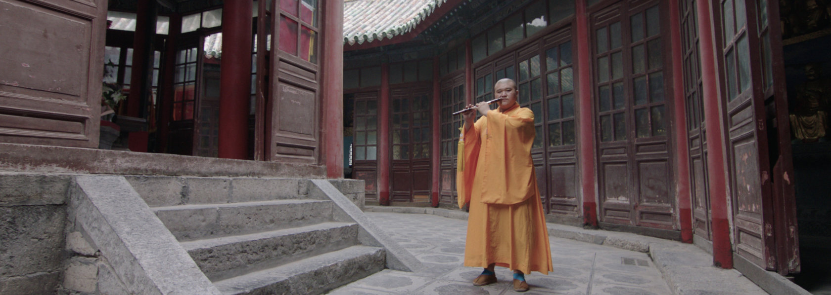 Monk playing Chinese flute in a temple - Music Monks - THIS Buddhist Film Festival