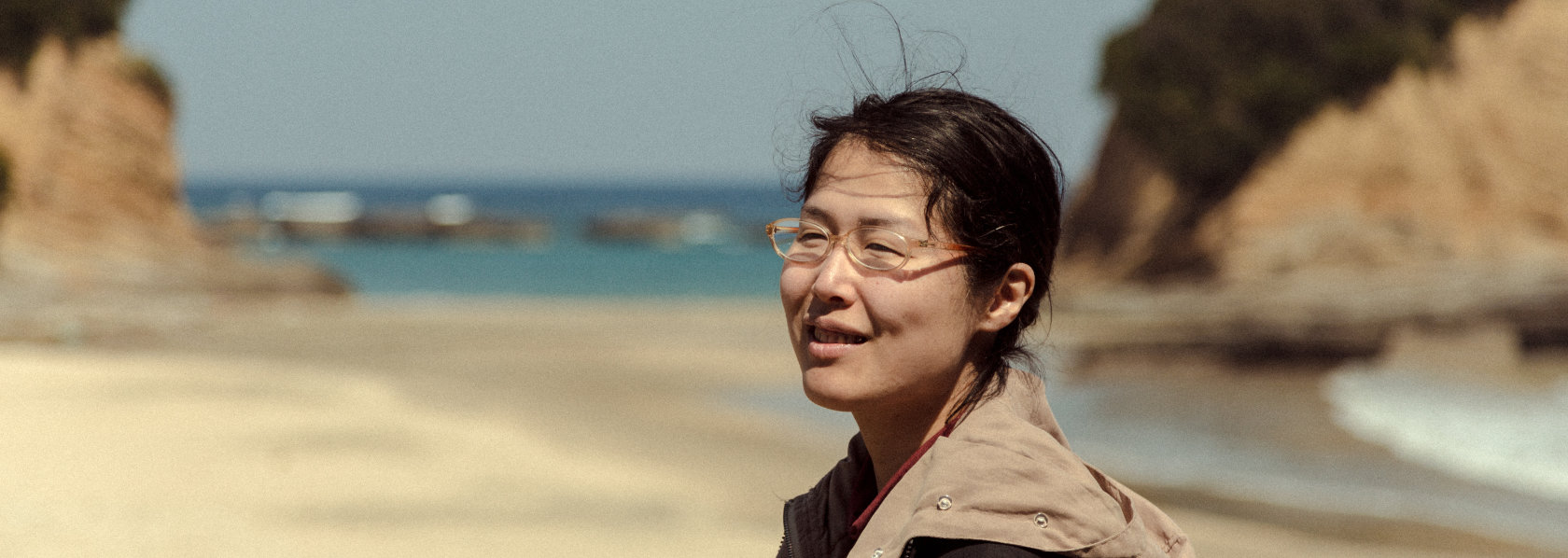 Woman at a beach - My Soul Drifts Light Upon a Sea of Trees - THIS Buddhist Film Festival
