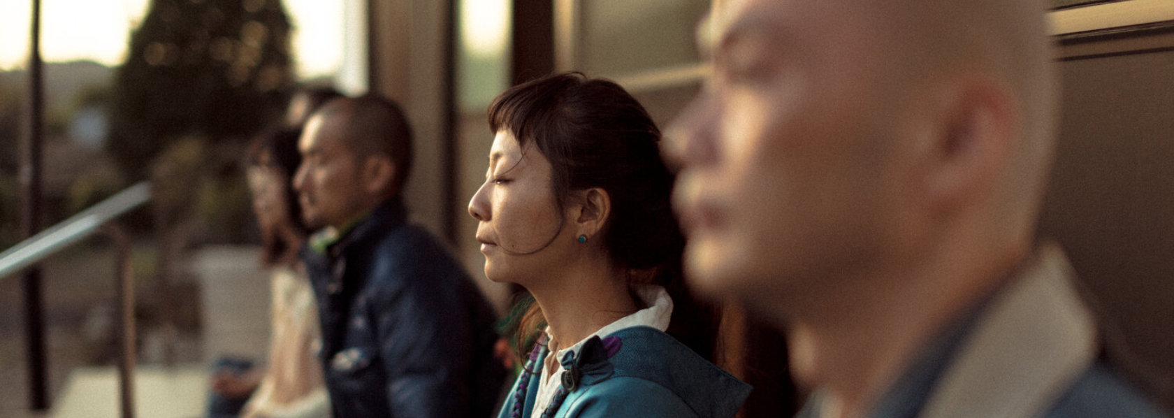 People meditating outside a house - My Soul Drifts Light Upon a Sea of Trees - THIS Buddhist Film Festival