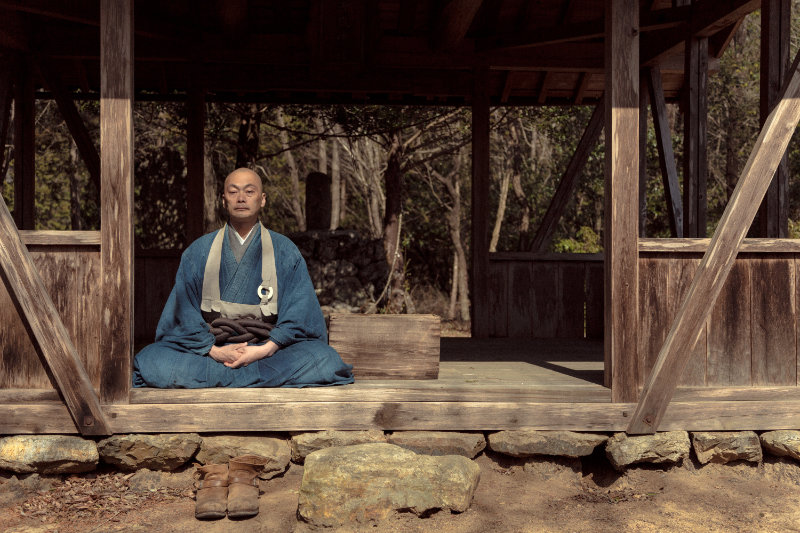 Zen monk sitting in a wooden hut - My Soul Drifts Light Upon a Sea of Trees - THIS Buddhist Film Festival