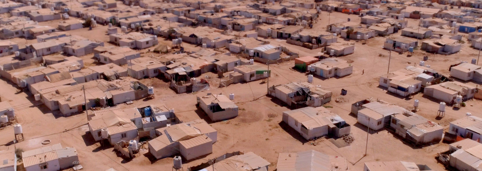 Aerial view of refugee camp in a desert - My Year of Living Mindfully - THIS Buddhist Film Festival
