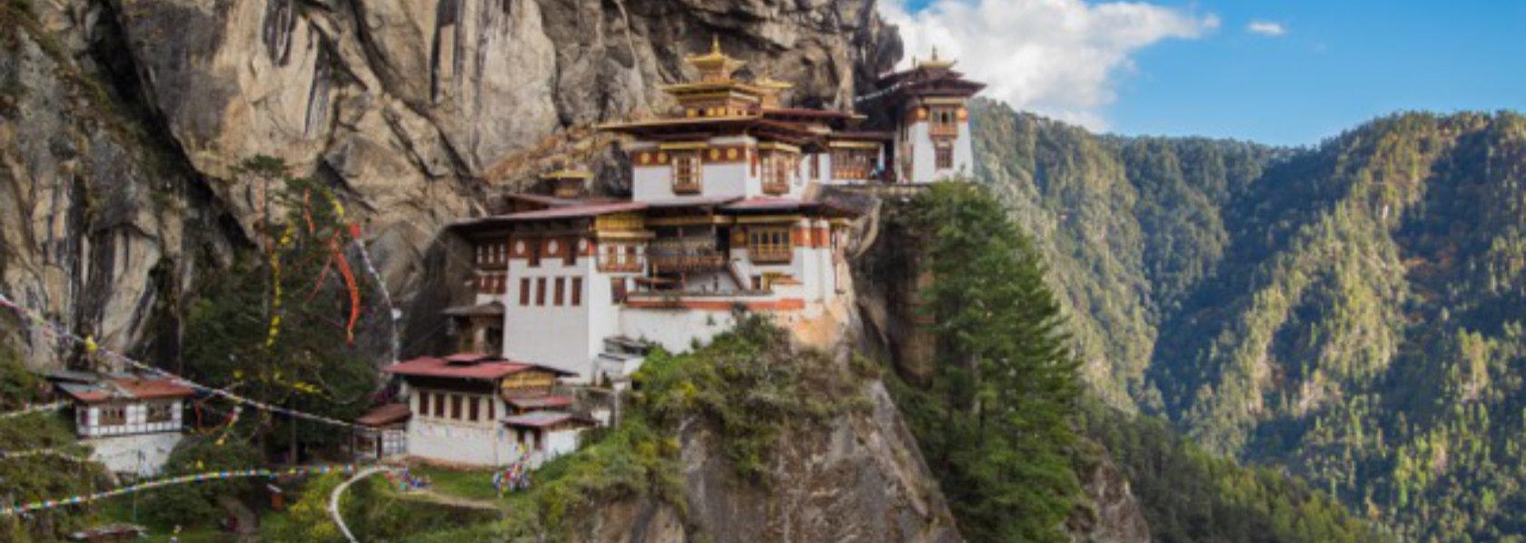 Paro Taktsang The Tigers Nest Monastery on cliffside - Precious Guru - THIS Buddhist Film Festival
