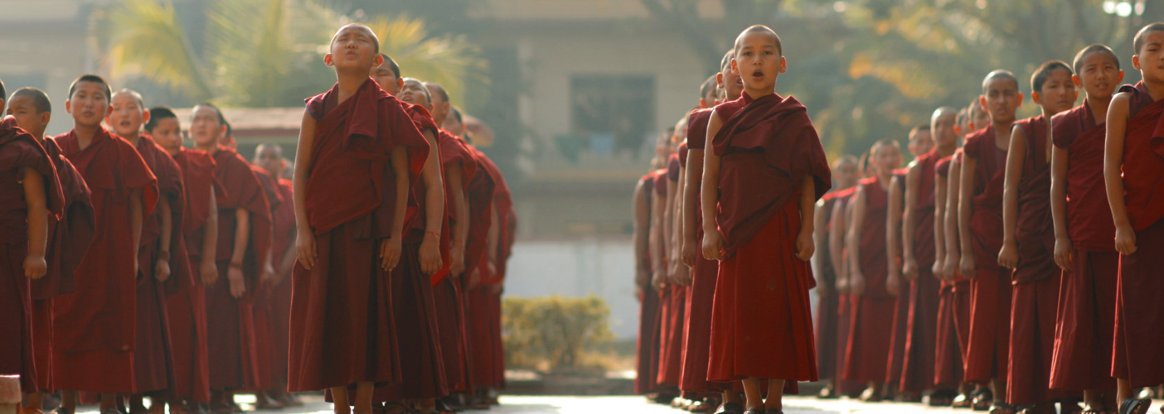 A group of young monks lining up for assembly - Saffron Heart - THIS Buddhist Film Festival