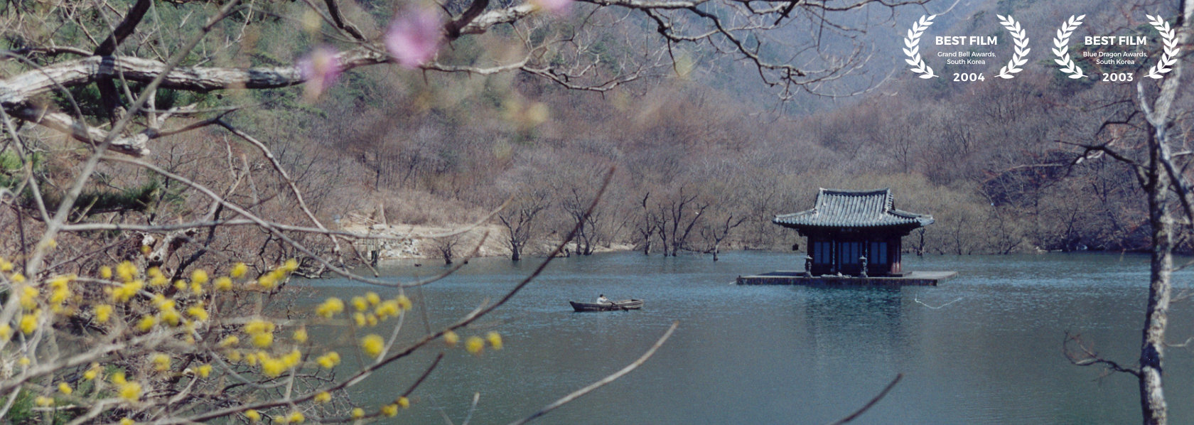 A boat rowing towards a small monstery in the middle of a lake - Spring Summer Fall Winter and Spring - THIS Buddhist Film Festival